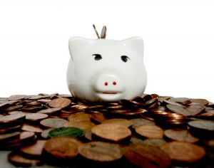 piggy bank and coins - save on health insurance in california