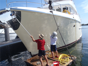 Boat insurance -men cleaning vessel