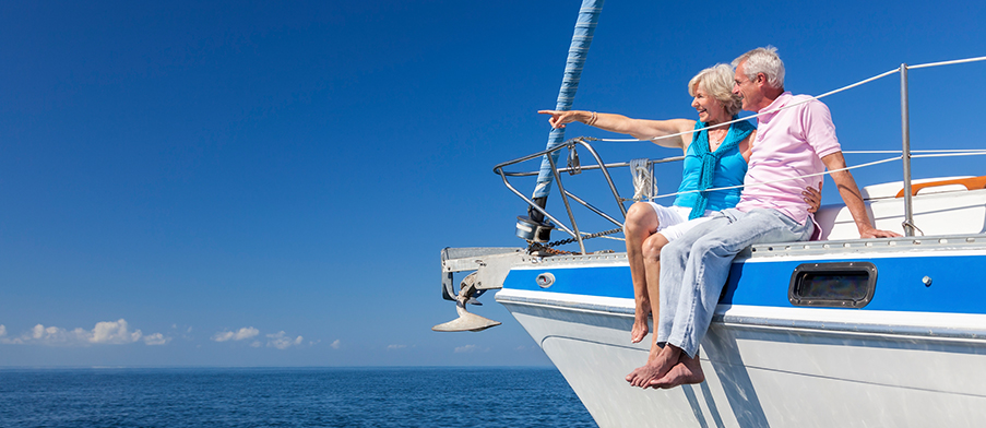 boat insurance - retired couple enjoying boat ride
