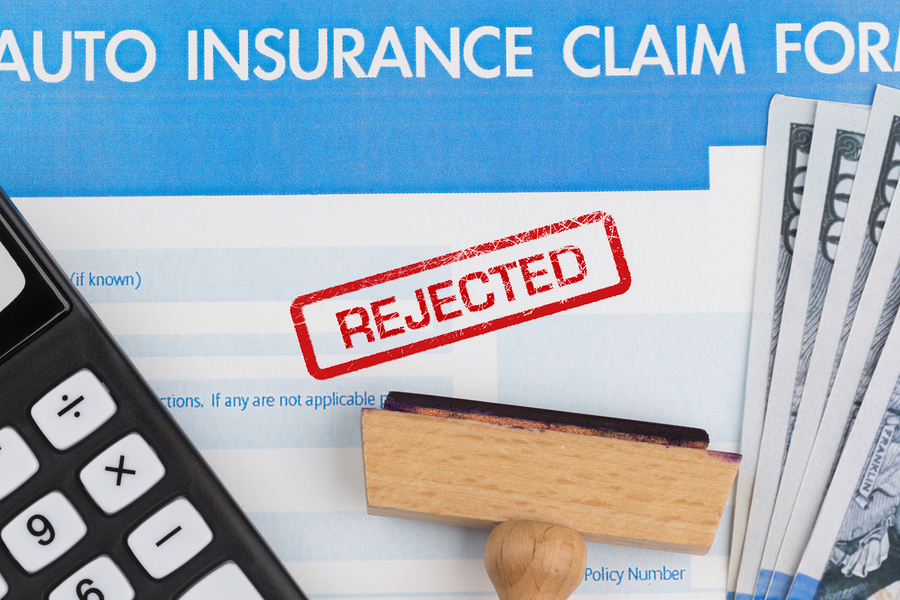 auto insurance claim form with dollar and calculator
