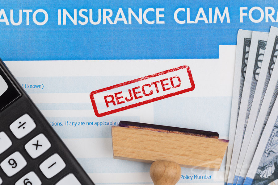 auto insurance claim form with dollar and calculator. AIS Auto Insurance Specialists offer a range of options for coverages.