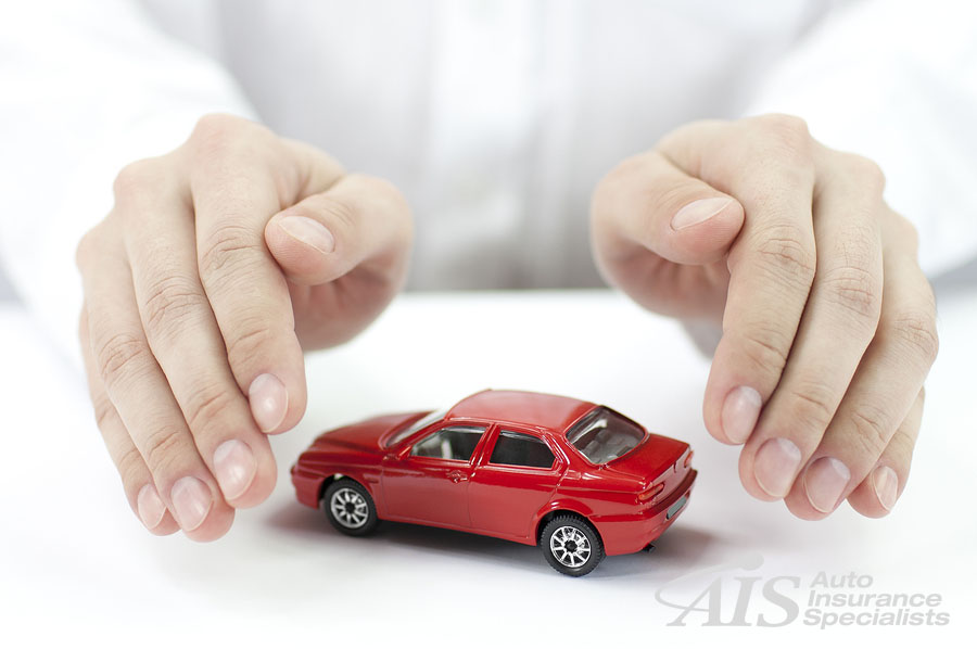 Man hands holding red car isolated on white background