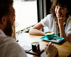 man woman meeting coffee