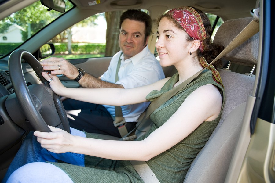 Auto Insurance Rates - teen daughter driving with dad