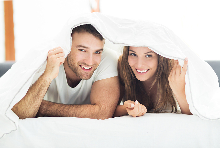 Auto insurance - Couple under bed covers