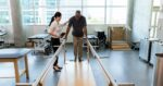 man getting physical therapy through Workers Compensation Insurance