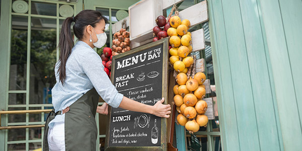 woman opening restaurant-Reopening Your Business