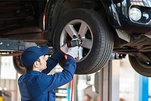 mechanic fixing tires