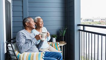 retirees on balcony