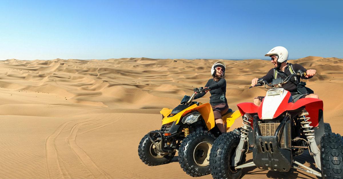 couple riding sand dunes