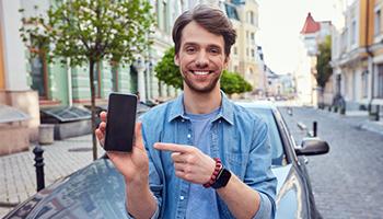 man showing app on phone