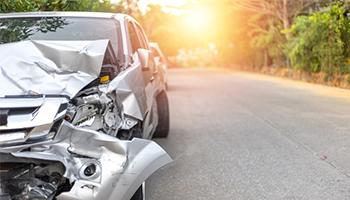 damaged front bumper of car